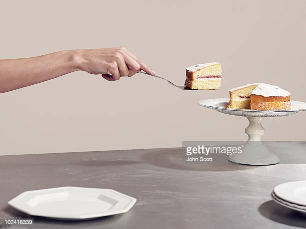 Woman serving a slice of cake