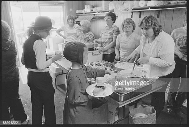 Woman Serving Amish Girl