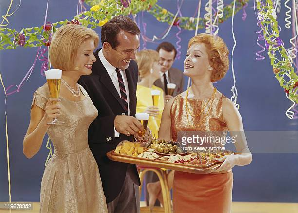 woman serving appetizers at party, smiling - archive stock pictures, royalty-free photos & images