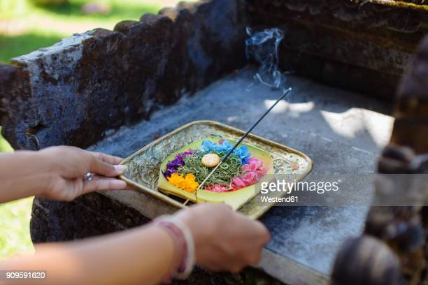 Woman serving Balinese offering