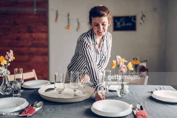Woman serving champagne glasses