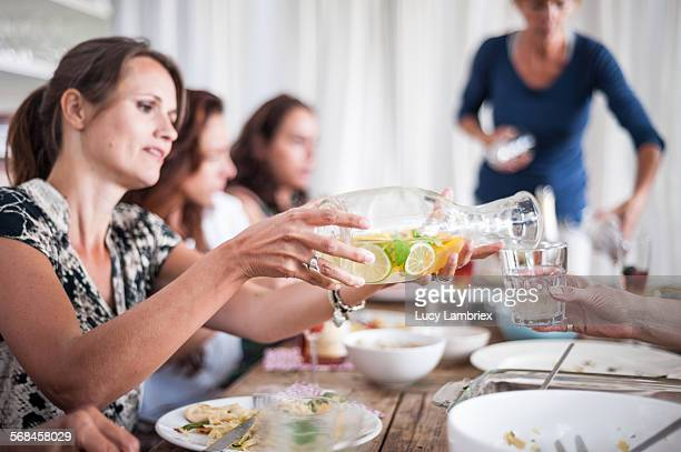 Woman serving citrus water