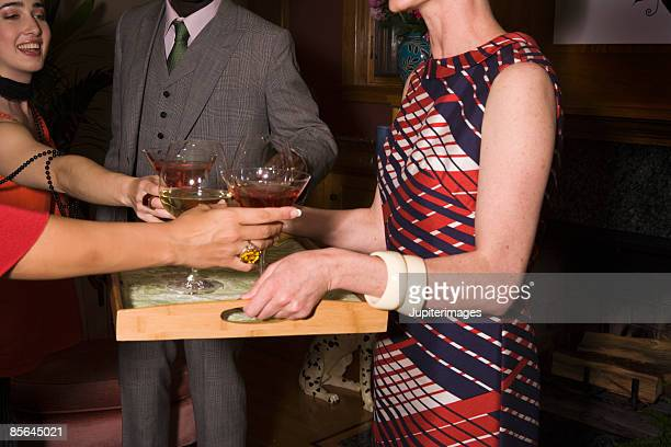 woman serving cocktails at party - グレンチェック ストックフォトと画像