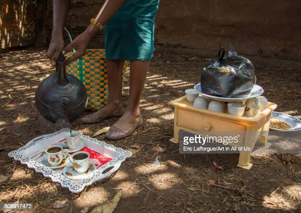 Woman serving coffee in a Gurage traditional house Gurage Zone Butajira Ethiopia on June 18 2017 in Butajira Ethiopia
