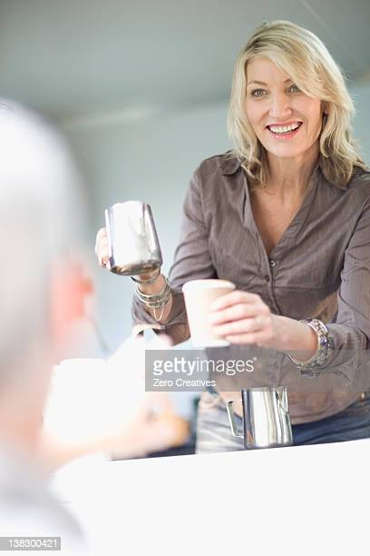 Woman serving coffee in food cart