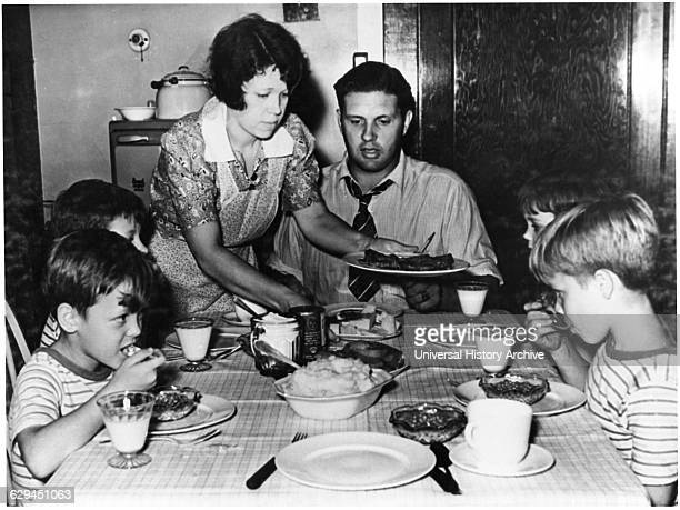 Woman Serving Family Dinner circa 1955 from the Documentary Film 'Emerging Woman' Women's Film Project 1974