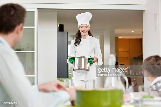 Woman serving food to her family