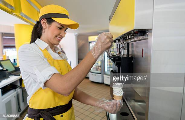 Woman serving ice cream at a shop
