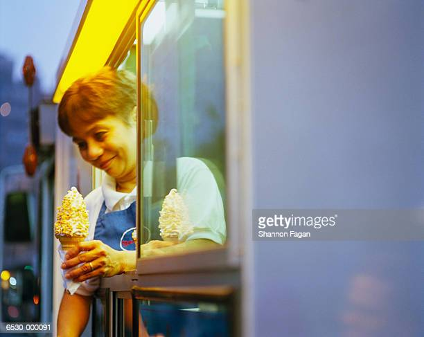 Woman Serving Ice Cream Cone