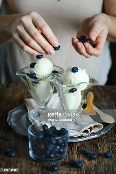 Woman serving ice cream in glass cup