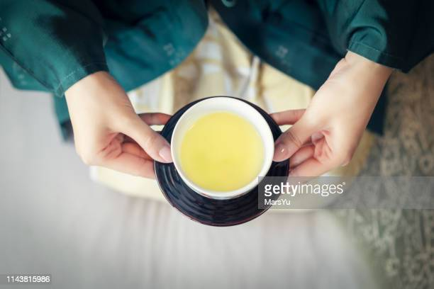 woman serving japanese tea - ceremony stock pictures, royalty-free photos & images