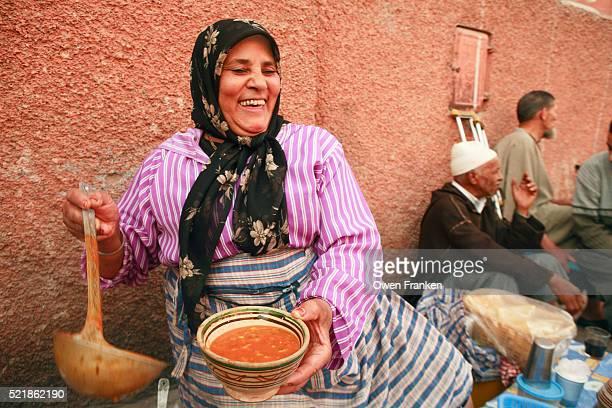 woman serving soup at market in marrakech - femme marocaine photos et images de collection