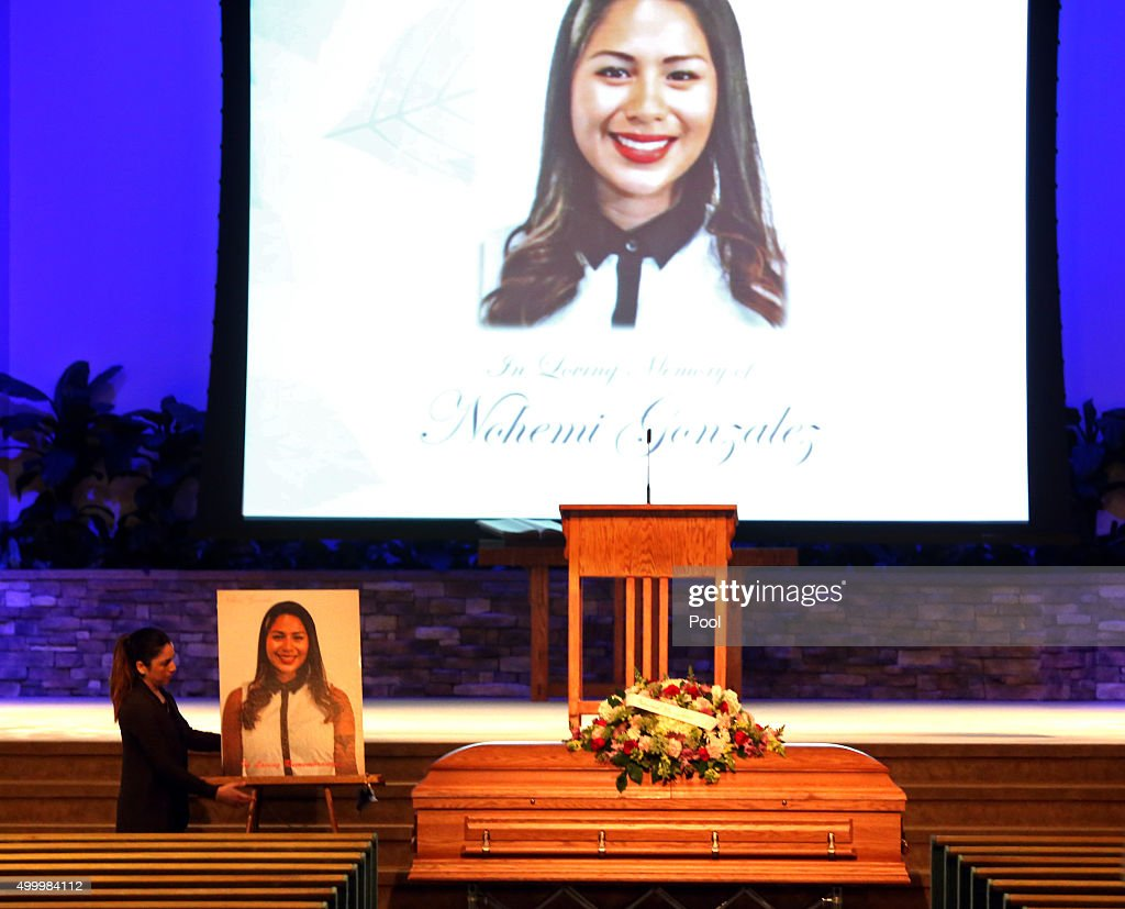 A woman sets up a picture of Paris terror attack victim Nohemi Gonzalez for her funeral service at the Calvary Chapel December 4, 2015 in Downey, California. Gonzalez was the 23 year-old Cal State Long Beach student who was killed while dining with friends at a bistro in Paris last month. Gonzalez, from El Monte, was a senior majoring in industrial design and one of 17 CSULB students attending Strate School of Design in Paris as part of a study abroad program. She was one of 129 people killed in the coordinated attacks.