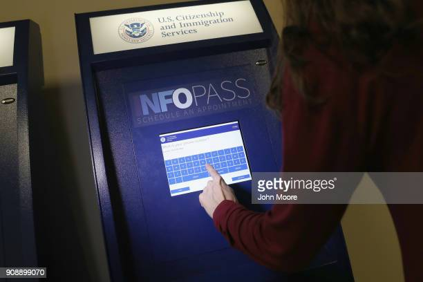 A woman sets up an appointment on an Infopass kiosk at US Citizenship and Immigration Services office on January 22 2018 in Newark New Jersey USCIS...