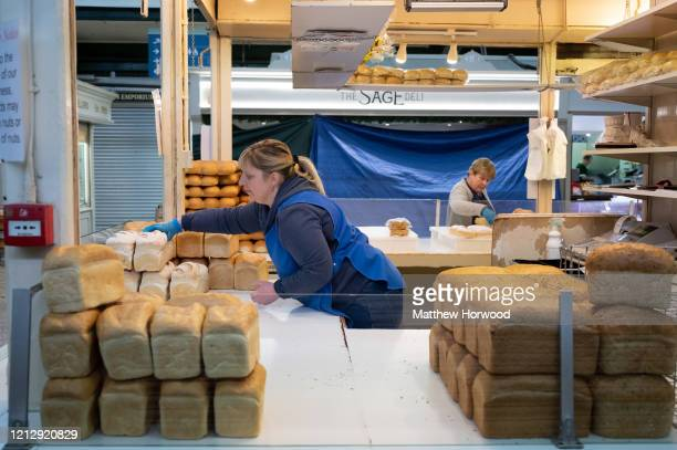 Woman sets up her bakery stall in Cardiff Market on March 17, 2020 in Cardiff, Wales. Boris Johnson held the first of his public daily briefing on...