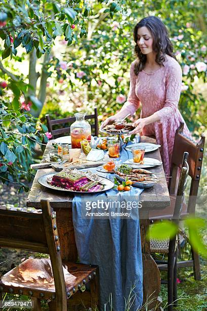 Woman Setting Table of Garden Tea Party