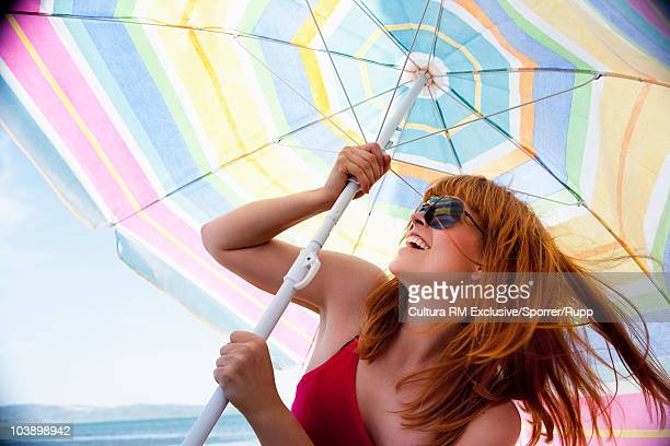 Woman setting up sunshade