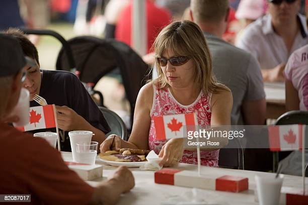 A woman settles down for a pancake breakfast as part of Canada Day festivities in this 2008 Penticton British Columbia Canada summer photo Canada Day...