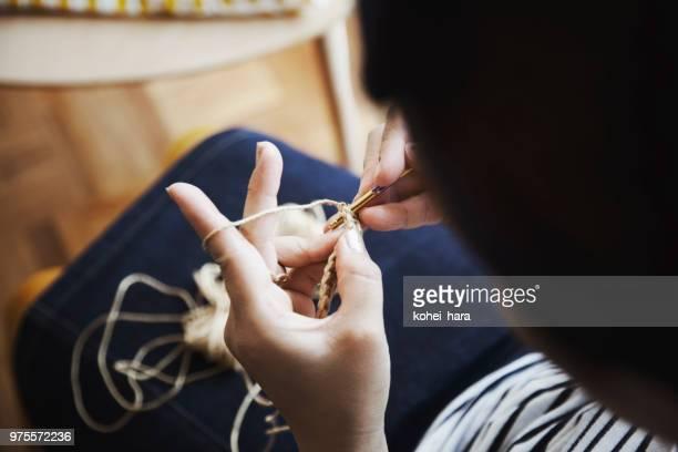 Woman sewing at home