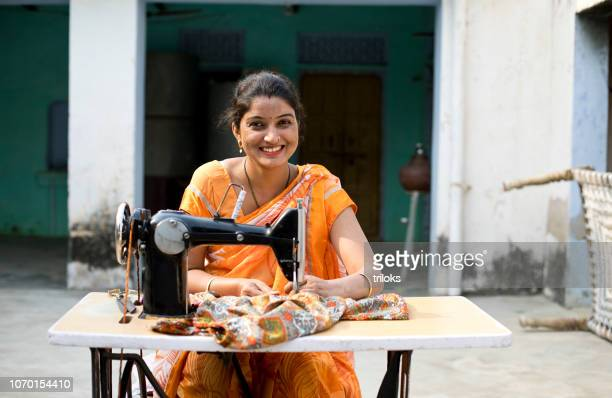 woman sewing clothes with sewing machine - indian ethnicity stock pictures, royalty-free photos & images