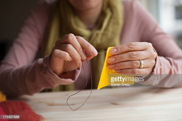 Woman sewing fabric