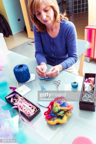 Woman Sewing Heart Shape Magic Wand