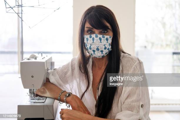 woman sewing homemade protective mask - homemade stock pictures, royalty-free photos & images