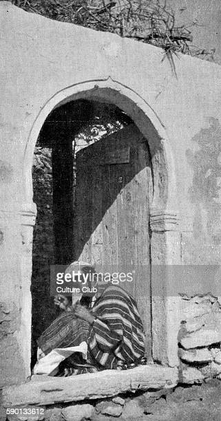 Woman sewing in the Jewish quarter of Djerba Tunisia Published in November 1923