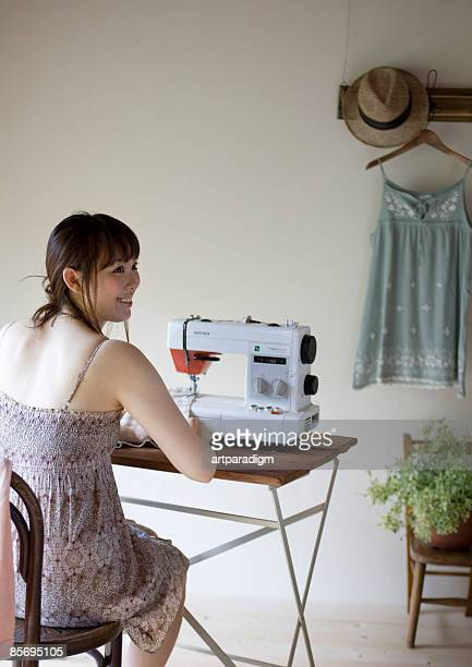 Woman sewing on a machine