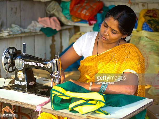 woman sewing - craft product stock photos and pictures