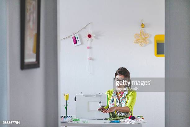 woman sewing - sewing machine stock pictures, royalty-free photos & images