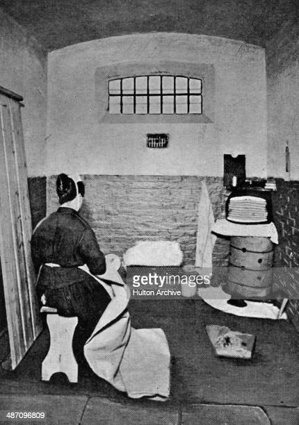A woman sewing sacks in a cell at Holloway Prison north London circa 1890 Built in 1852 HM Prison Holloway became a femaleonly prison in 1903