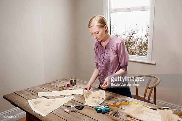 woman sewing,preparing pattern. - sewing stock pictures, royalty-free photos & images