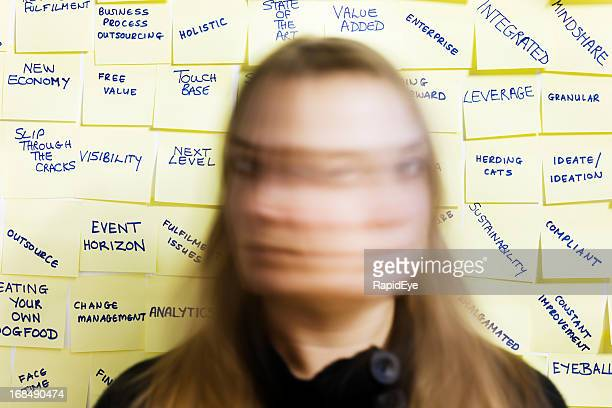 Woman shakes head in blurred motion against business buzzwords