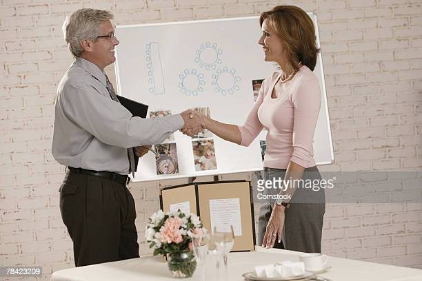 Woman shaking hands with wedding planner