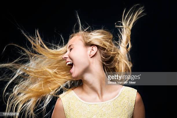 Woman shaking her hair.