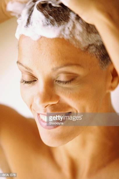 Woman shampooing hair