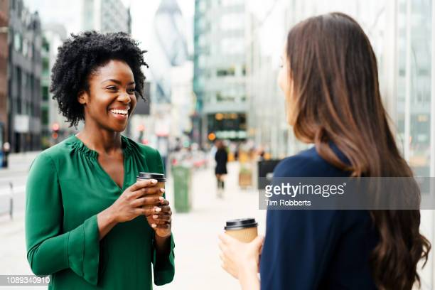 woman sharing coffee together - colleague photos et images de collection