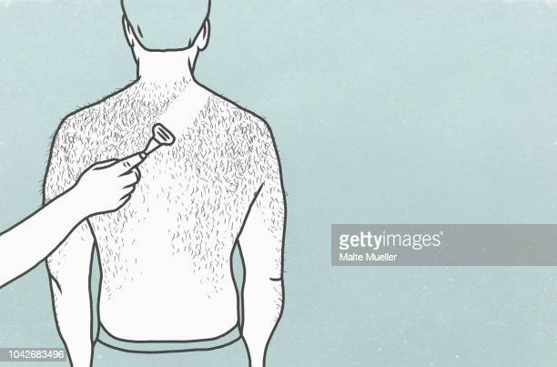 woman shaving back of hairy man with razor - hairy man chest stock photos and pictures