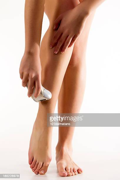 Woman shaving her legs with razor