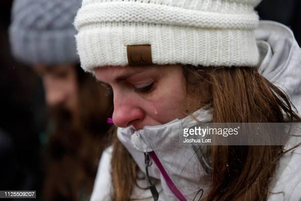 A woman sheds a tear as she attends a prayer vigil outside Henry Pratt Company on February 17 2019 in Aurora Illinois Six people including a gunman...