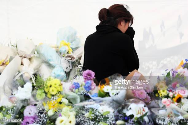 A woman sheds tears at a makeshift altar at the Kyoto Animation Studio on July 24 2019 in Kyoto Japan Thirtyfour people were killed after Shinji Aoba...