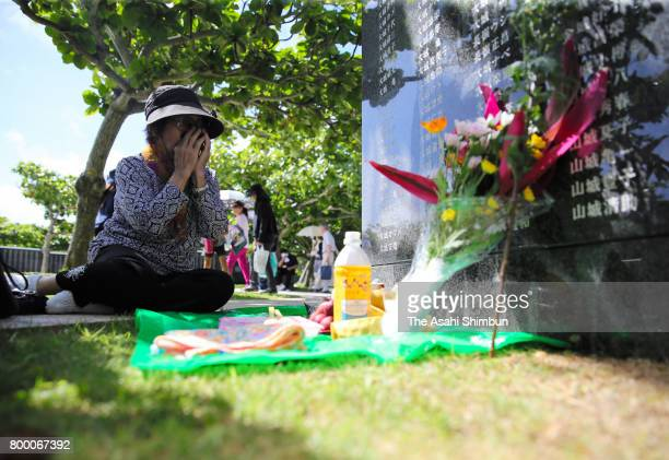 A woman sheds tears in front of the Cornerstone of Peace where the names of their bereaved family members and relatives engraved at the Peace...