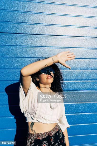 Woman shielding eyes from sun glare