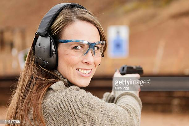 woman shooter at the shooting range - guns stock photos and pictures