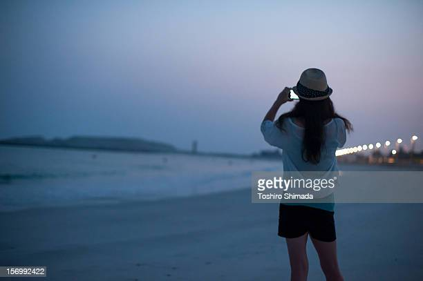 A woman shooting in the dawn