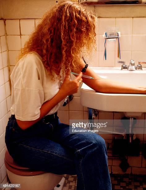 Woman Shooting Up Heroin In Bathroom