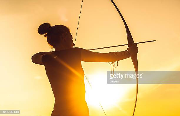 Woman shooting with the longbow