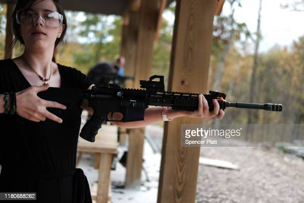 """Woman shoots an AR-15 rifles and other weapons at a shooting range during the """"Rod of Iron Freedom Festival"""" on October 12, 2019 in Greeley,..."""