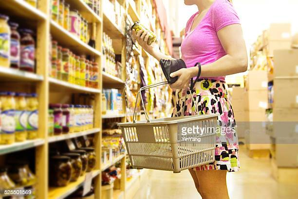 Woman Shopper Shopping in Supermarket Grocery Store Making Choices, Selections